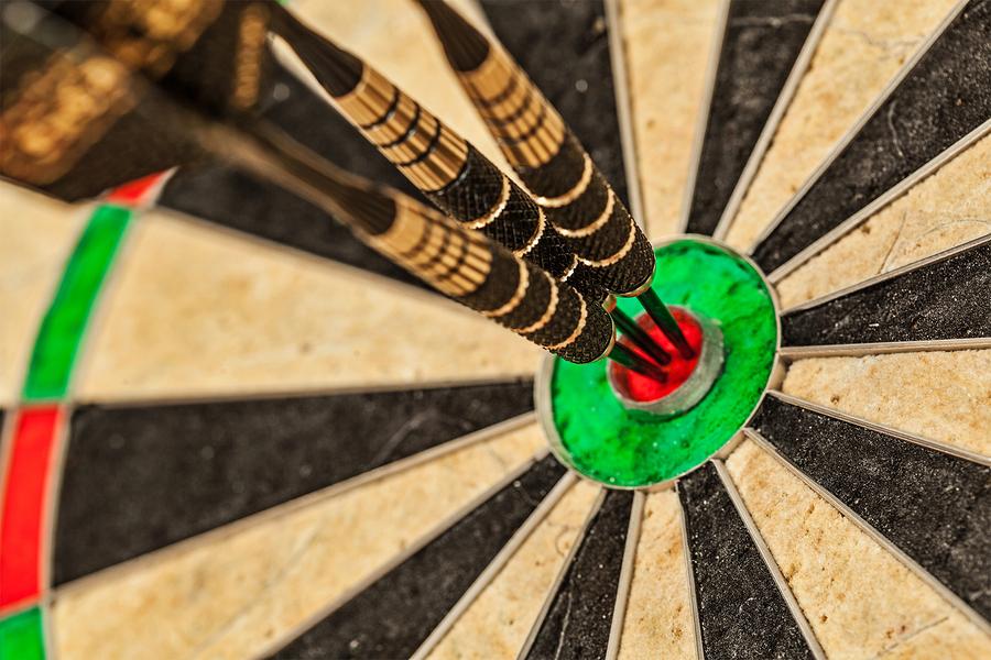 Success hitting target aim goal achievement concept background -